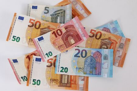 Many different euro bills lie on a white background Reklamní fotografie