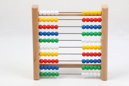 Small ruler with colorful wooden balls in a white studio 版權商用圖片