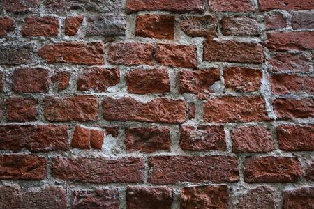 Closeup of a very old crumbling brick wall