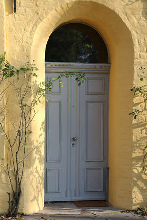 Beautiful old wooden door from a yellow old apartment building Stok Fotoğraf