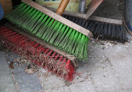 Close-up of different colored brooms