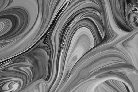 black and white of two squirled colors