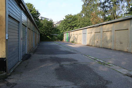 different colorful old closed garages in a row