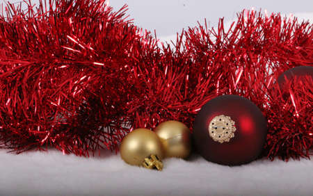 gold and red colored christmas decoration in the studio Stock Photo