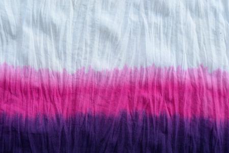 tie dye pattern dip dyed technique on cotton fabric background. Foto de archivo