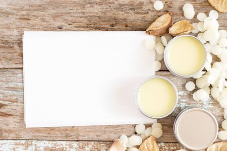 homemade natural lip balm in tin pots on blank recipe paper, how to make homemade natural lip balm, D.I.Y. projects, Foto de archivo
