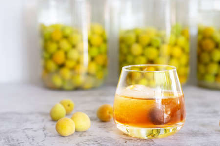 'Umeshu' on rock, a glass of Japanese plum wine 'Umeshu' with iced.