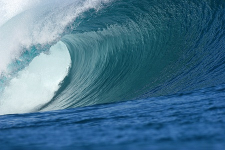 hollow wall: big wave producing a big barrel with beautiful texture and amazing colours