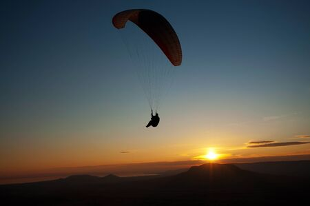 Paraglider in sunset