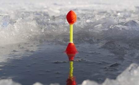 Fishing on ice in the month of January photo