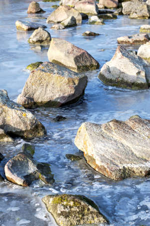 Stones on the frozen lake Stock Photo - 12025140