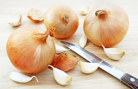 Onion and garlic on chopping board Stock Photo - 12025123