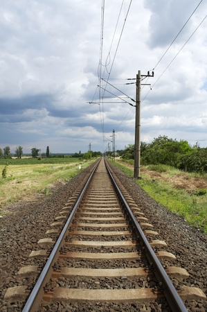 Straight railway leads to the horizon