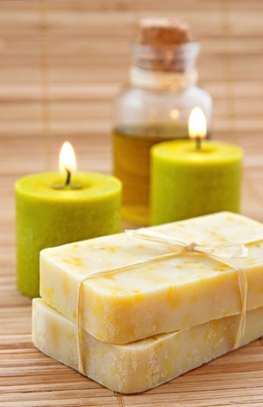 Hand-made marigaold (Calendula officinalis) soap with olive oil and candles