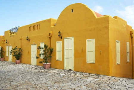 Yellow house in mediterranean street