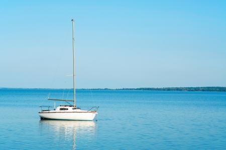 Sailboat on Lake Balaton in summer photo