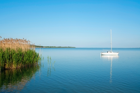 Sailboat on Lake Balaton in summer time photo