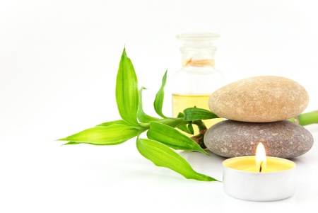Spa concept with stones,oil and bamboo photo