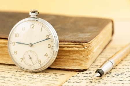 Antique book and clock photo