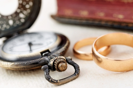 Pocket watch and wedding rings