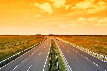Four-lane motorway in sunset, Hungary Stock Photo