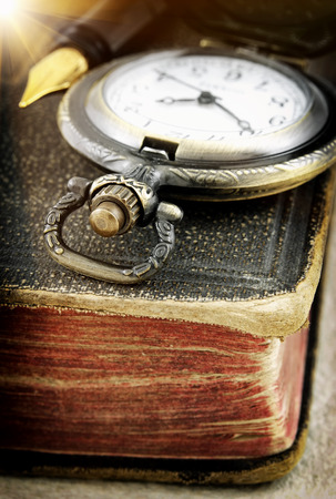 Old book and pocket watch  macro photo  photo