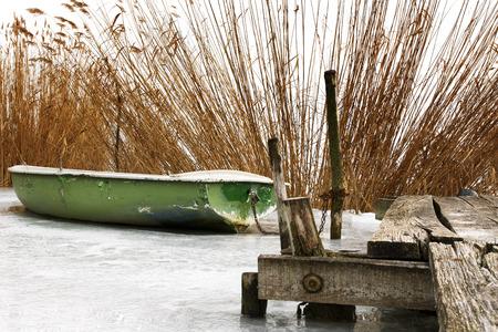 natural ice pastime: Angler boat on ice at Lake Balaton, Hungary