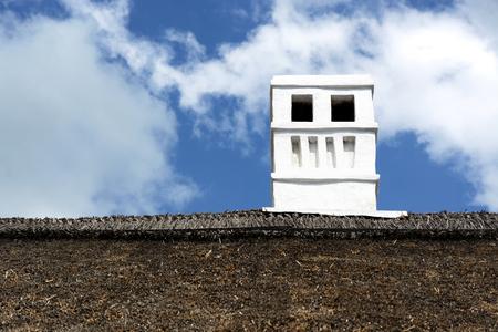 Old chimney on farmhouse Stock Photo