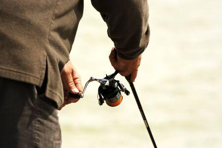 Angler is spinning at Lake Balaton, Hungary Stock Photo