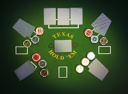 Poker cards and chips lying on green poker cloth. Texas Hold'em. Stock Photo