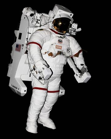 spacesuit: American astronaut wearing white spacesuit and propellant tank while exploring the dark outer space during a spatial expedition