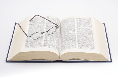 open dictionary with glasses