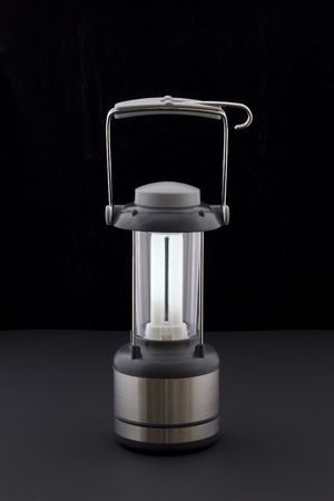 hurricane lamp: A lit hurricane lamp Stock Photo