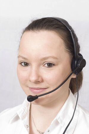 A smiling girl wearing a telephone headset