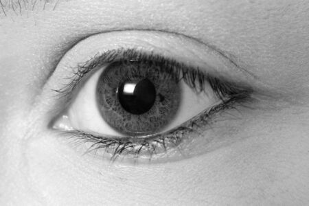 A black and white picture of a girls eye