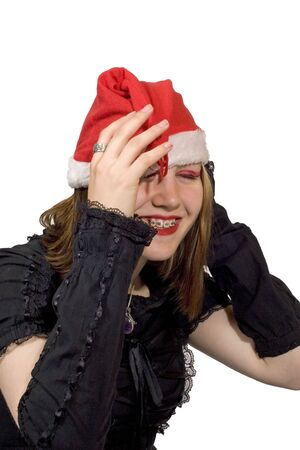 A pretty young lady in a christmas hat laughing