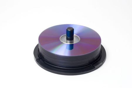 a spindle containing a piles of cdsdvds Stock Photo