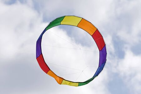 A circular shaped kite flying in the sky