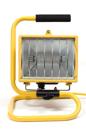 A yellow halogen light for use outside in constrruction or markts Stock Photo