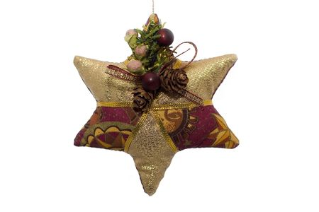 A fabric christmas ornament shaped like a star on a white background