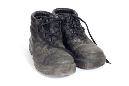 A pair of safety boots dirty after a day at work Stock Photo
