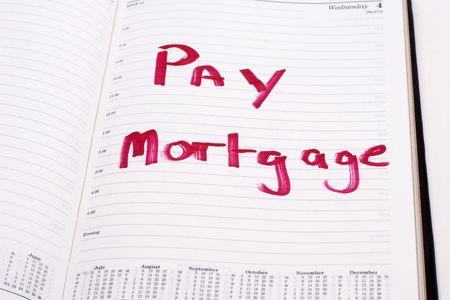 An open diary with a reminder to pay the mortgage