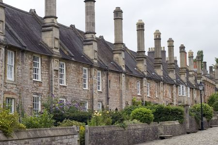 A row of old terraced houses on a cobbled street Stock Photo