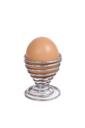 A brown hens egg in an eggcup