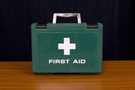A green first aid kit Stock Photo