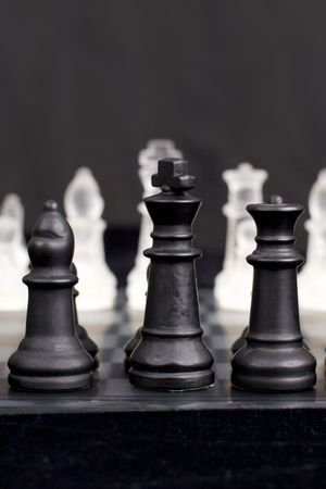 start of a game of chess close up on black king, with very shallow depth of field