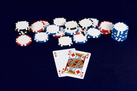Ace & king of diamonds together with poker chips Editorial