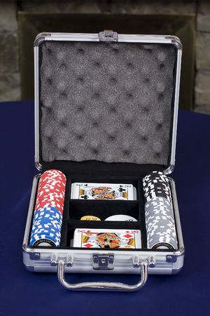 A poker set with cards and chips in a metal case
