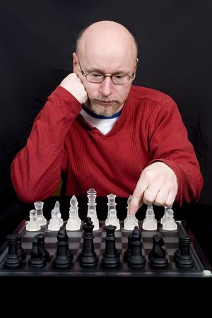 A man thinking about his opening chess move