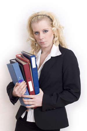 A young attractive businesswoman carrying folders